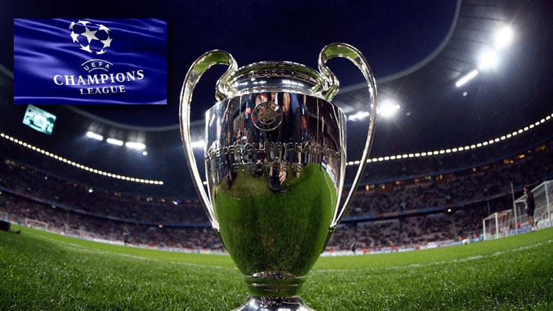 Champions League-flagga med buckla på gräset av fotbollsplan. Tar dig till fotbollsresor och fotbollsbiljetter till Europa och Champions League